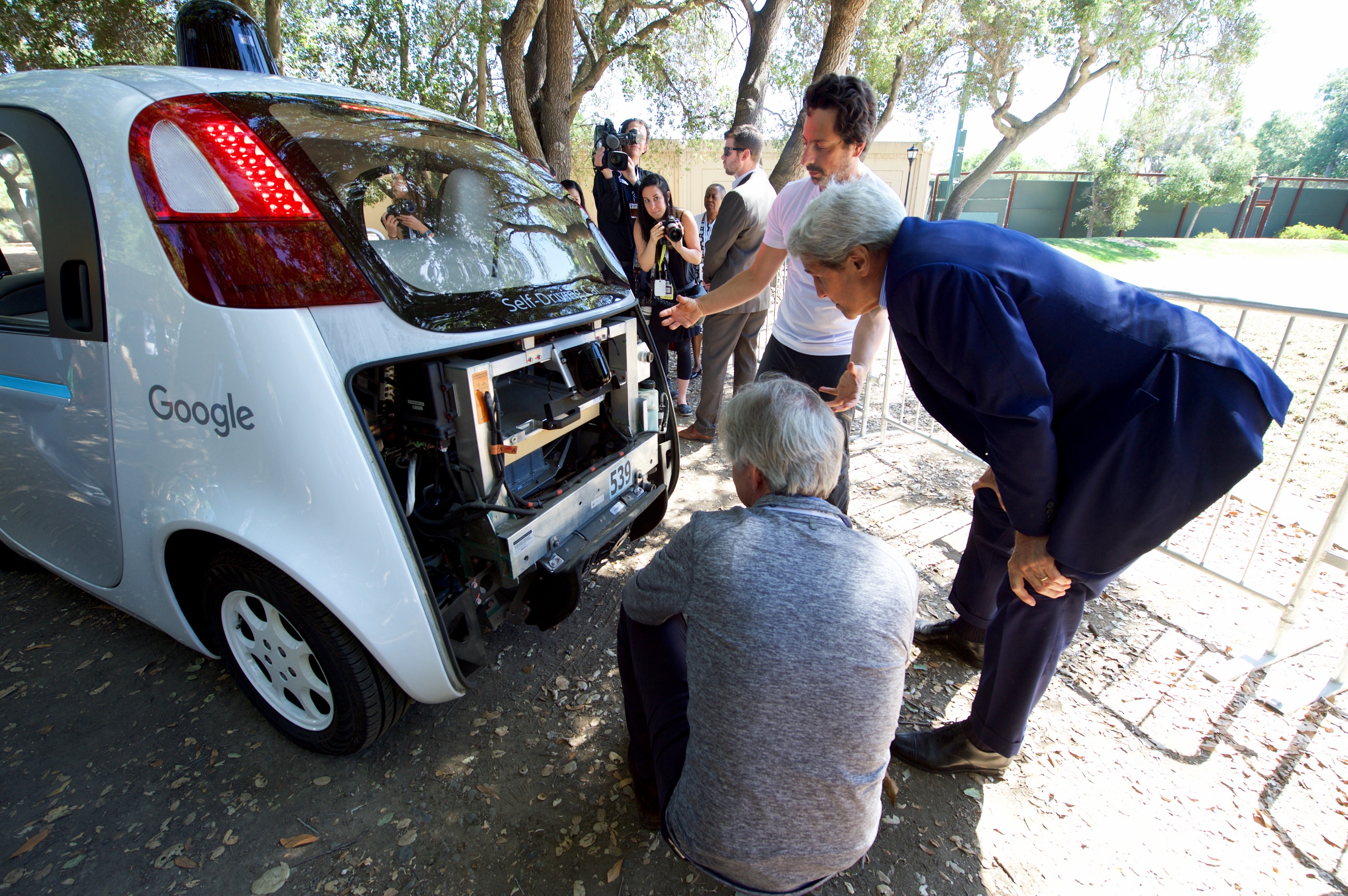 Secretary Kerry Views the Computers Inside One of Google's Self-Driving Cars at the 2016 Global Entrepreneurship Summit's Innovation Marketplace