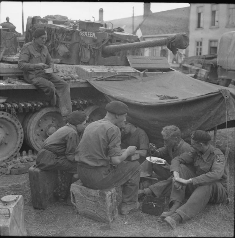 The tank crew shares their meal with a French boy