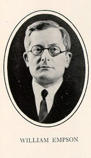 Formal portrait of William Empson, clean-shaven, wearing eyeglasses and dressed in a coat and tie
