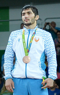 2016 Summer Olympics, Men's Freestyle Wrestling 65 kg awarding ceremony 2 (Ikhtiyor Navruzov cropped).jpg