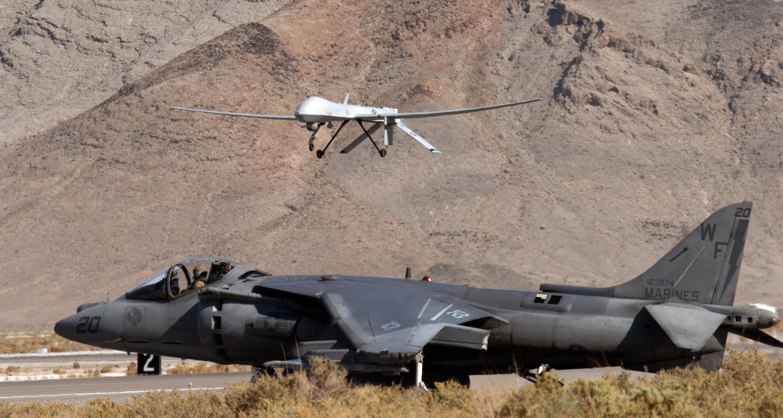 File:A U.S. Marine Corps AV-8B Harrier waits as an 11th ...