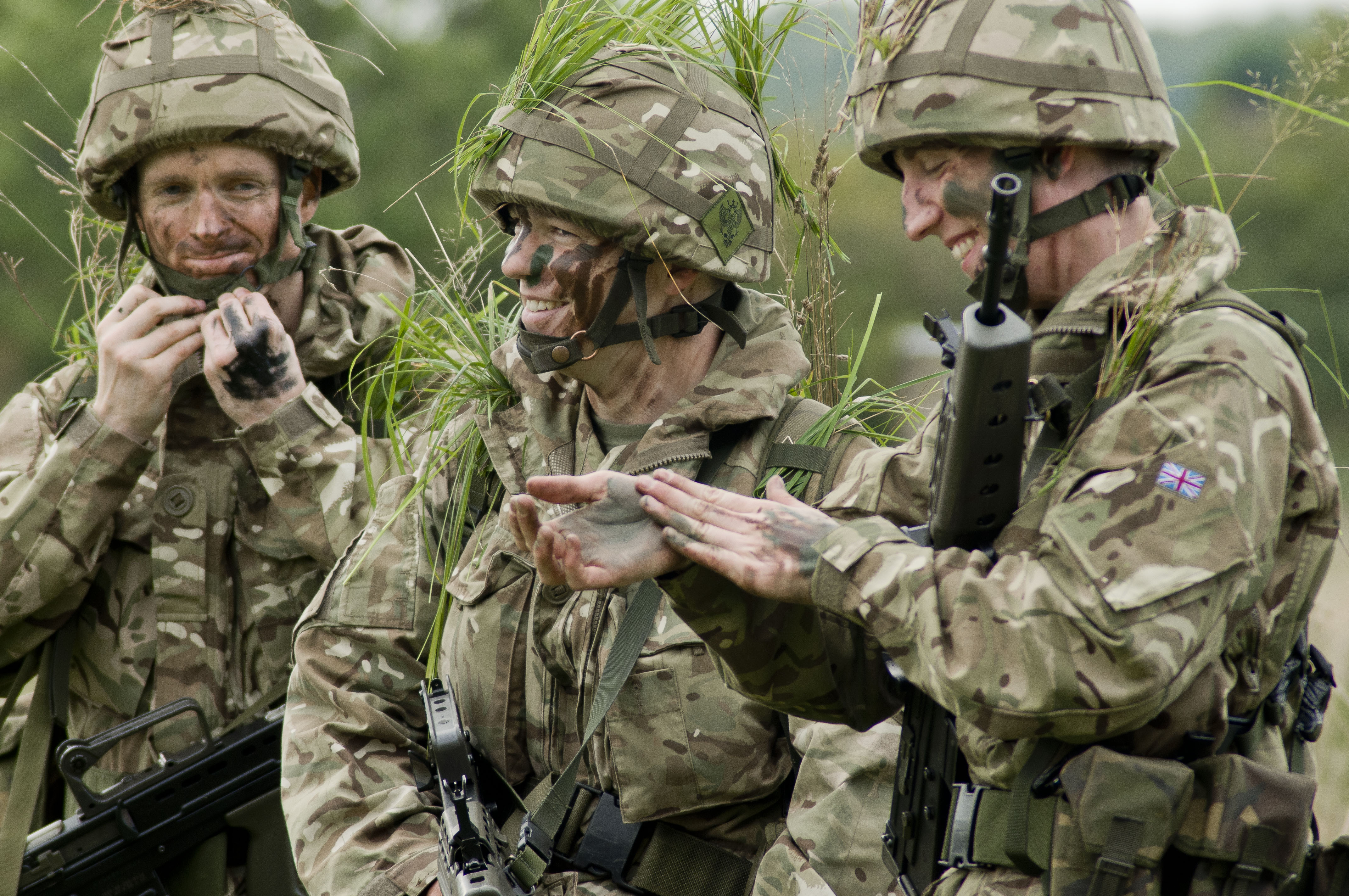 file army reservists applying camouflage mod 45156161