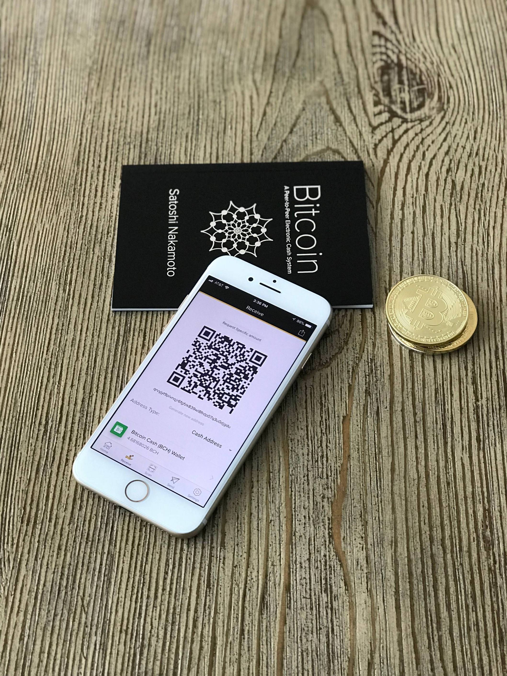 Bitcoin Cash wallet and whitepaper 2.jpg English: Photo of a mobile phone displaying a Bitcoin Cash wallet and a copy of Bitcoin A Peer-to-Peer