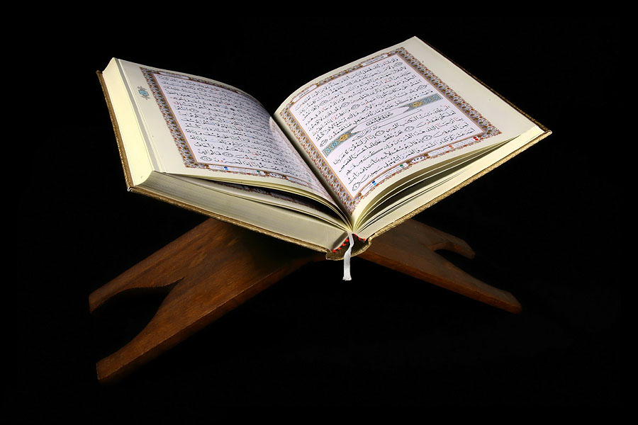 Quran opened, resting on a stand