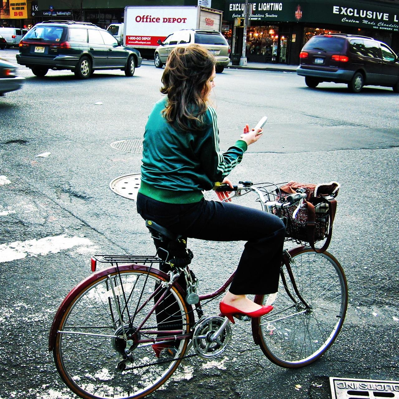 Biker looking at her phone?