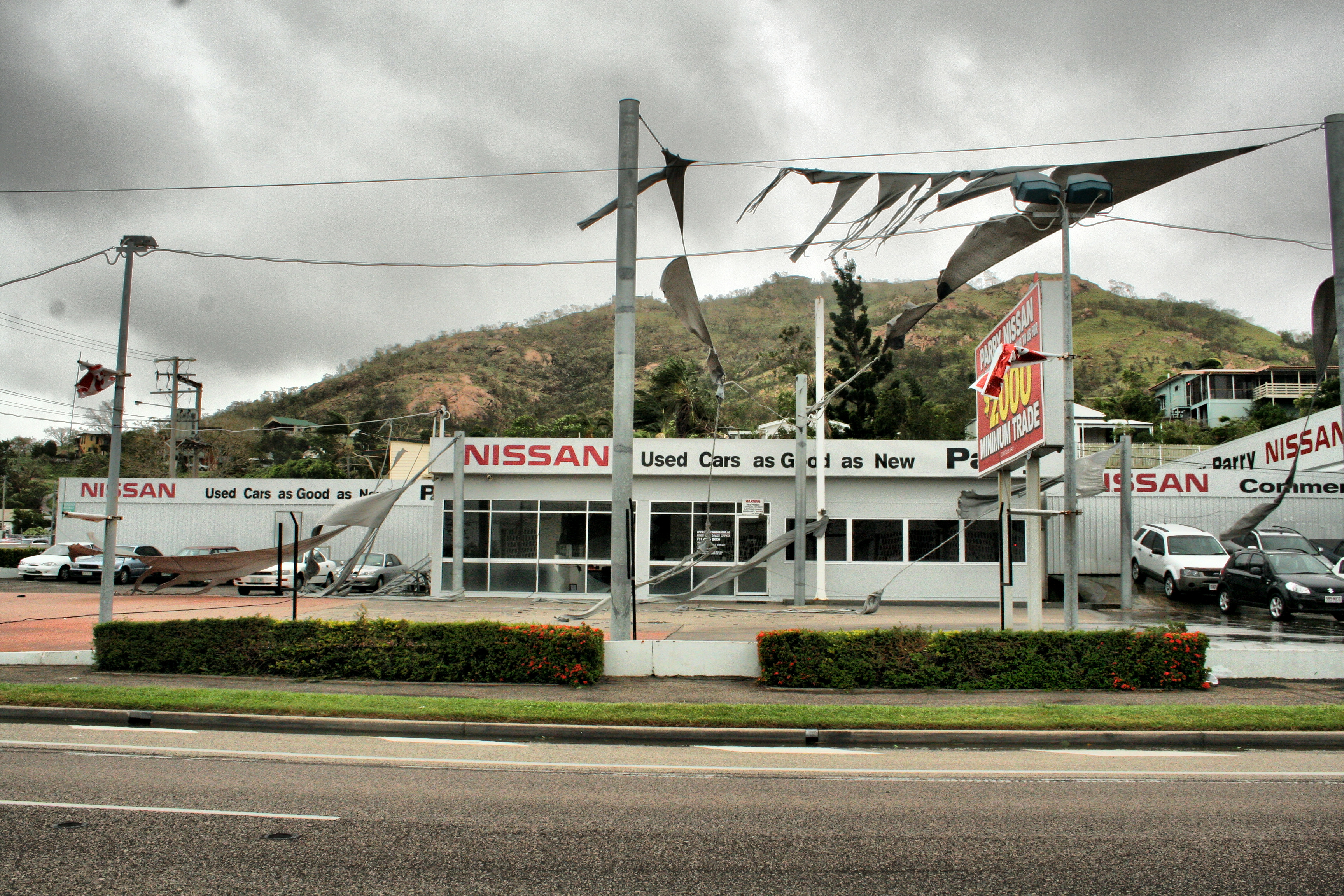 File:Torn shade sails at a used car lot in Townsville.jpg