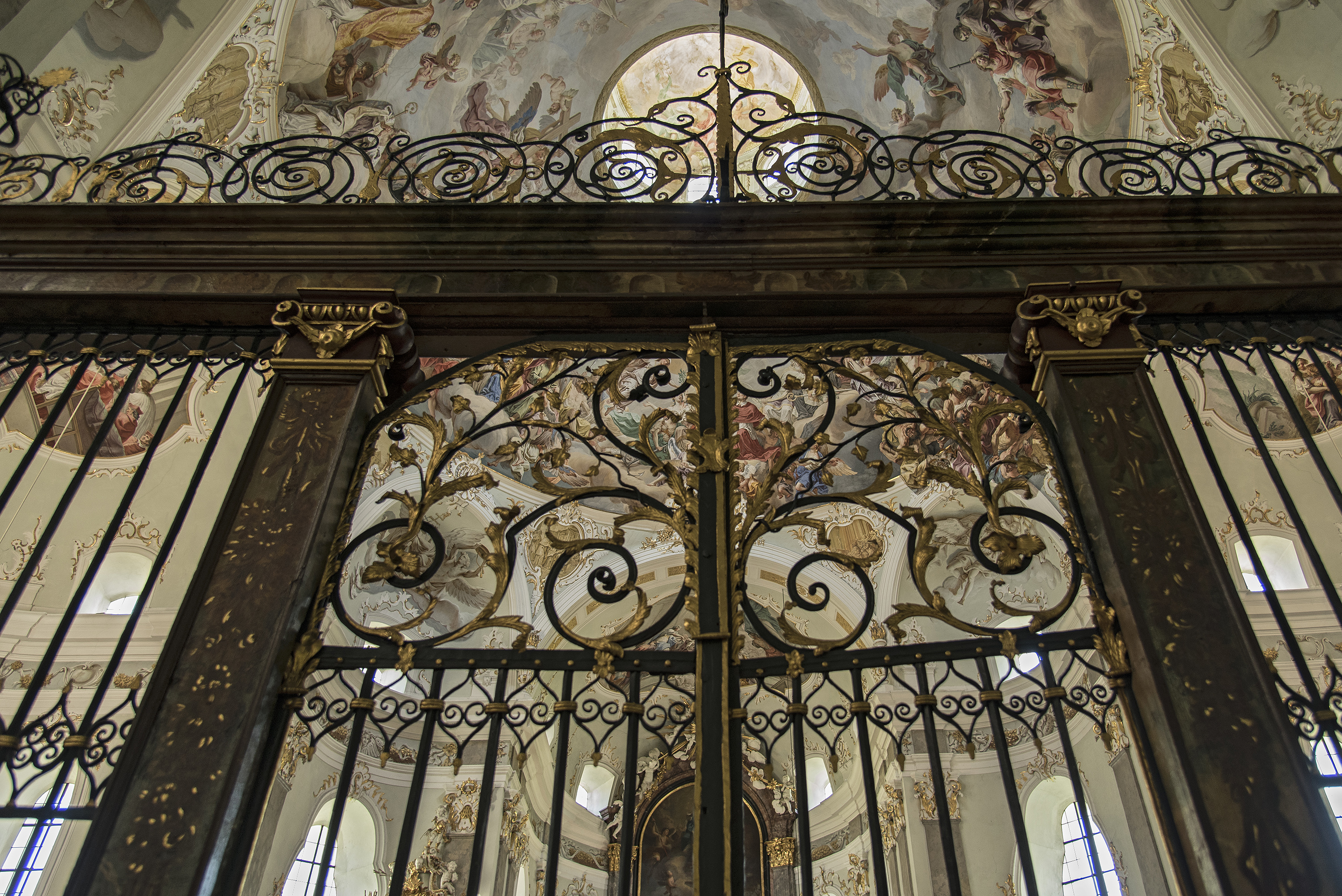 An elaborate wrought iron grille.