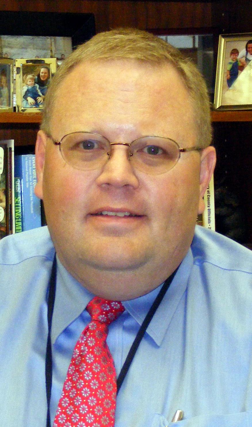 Warren E . Miller