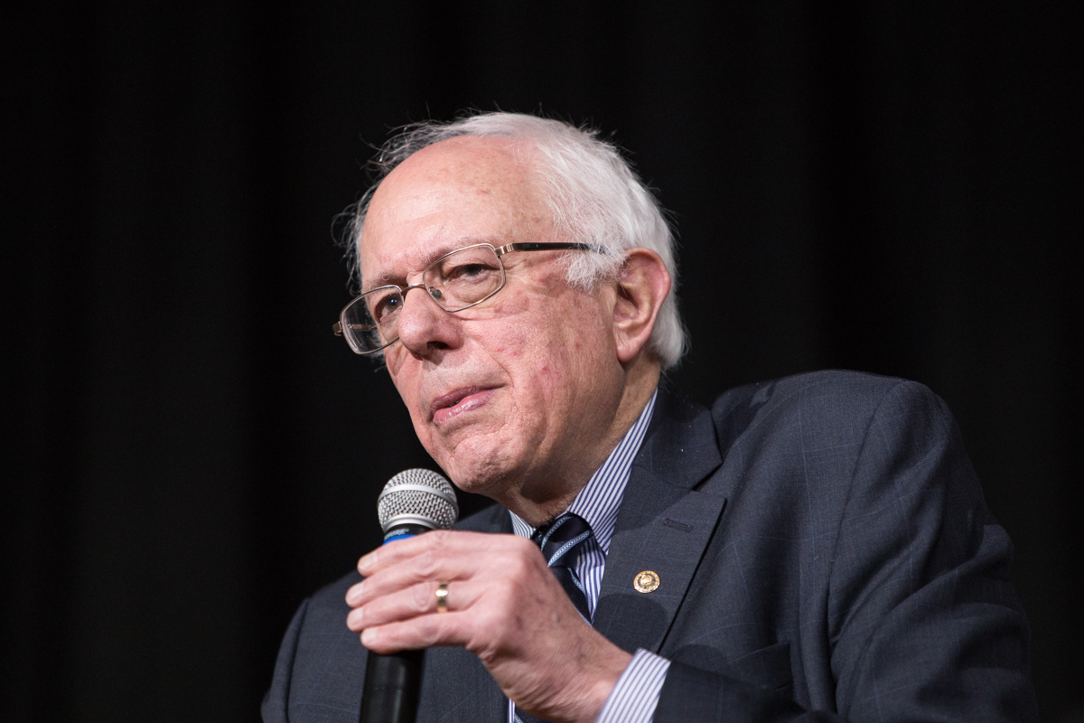 Sanders wants to restore net neutrality and use antitrust rules to unwind telecoms Phil Roederfrom Des Moines, IA, USA,Bernie Sanders at Roosevelt High School (24050281453),CC BY 2.0