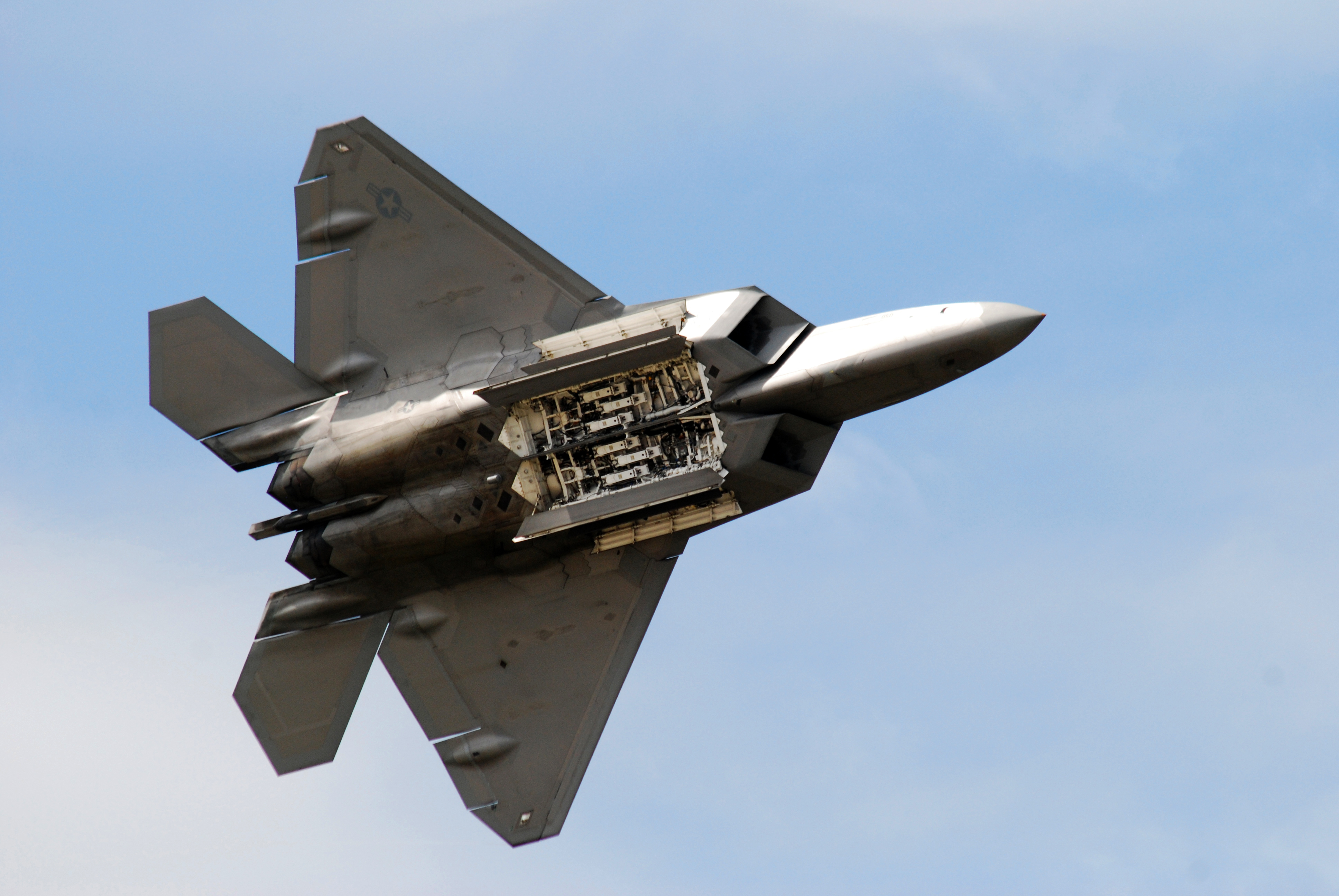 f 22 raptor gives us a peek of what s under her blouse