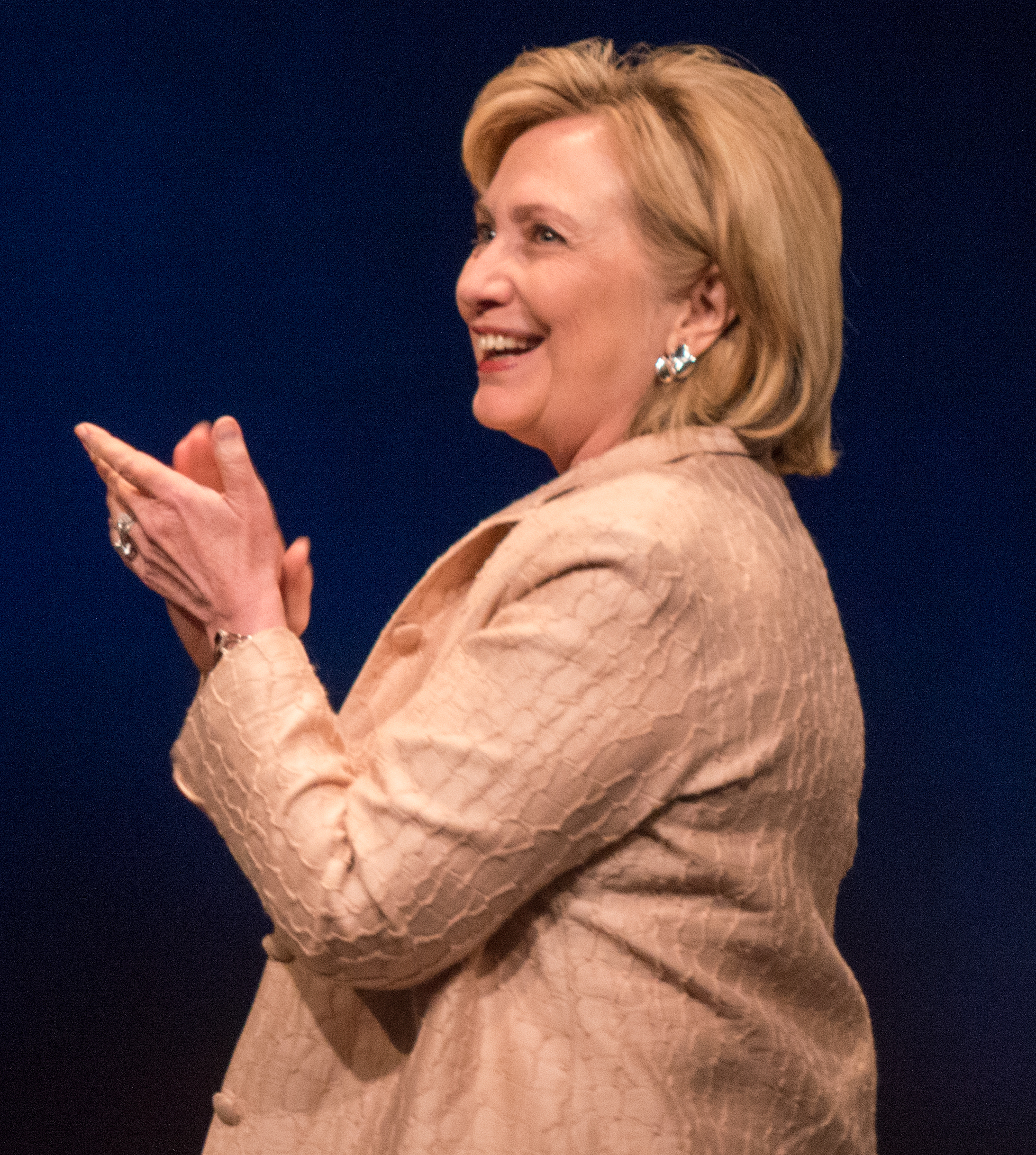Hilary Clinton in profile clapping