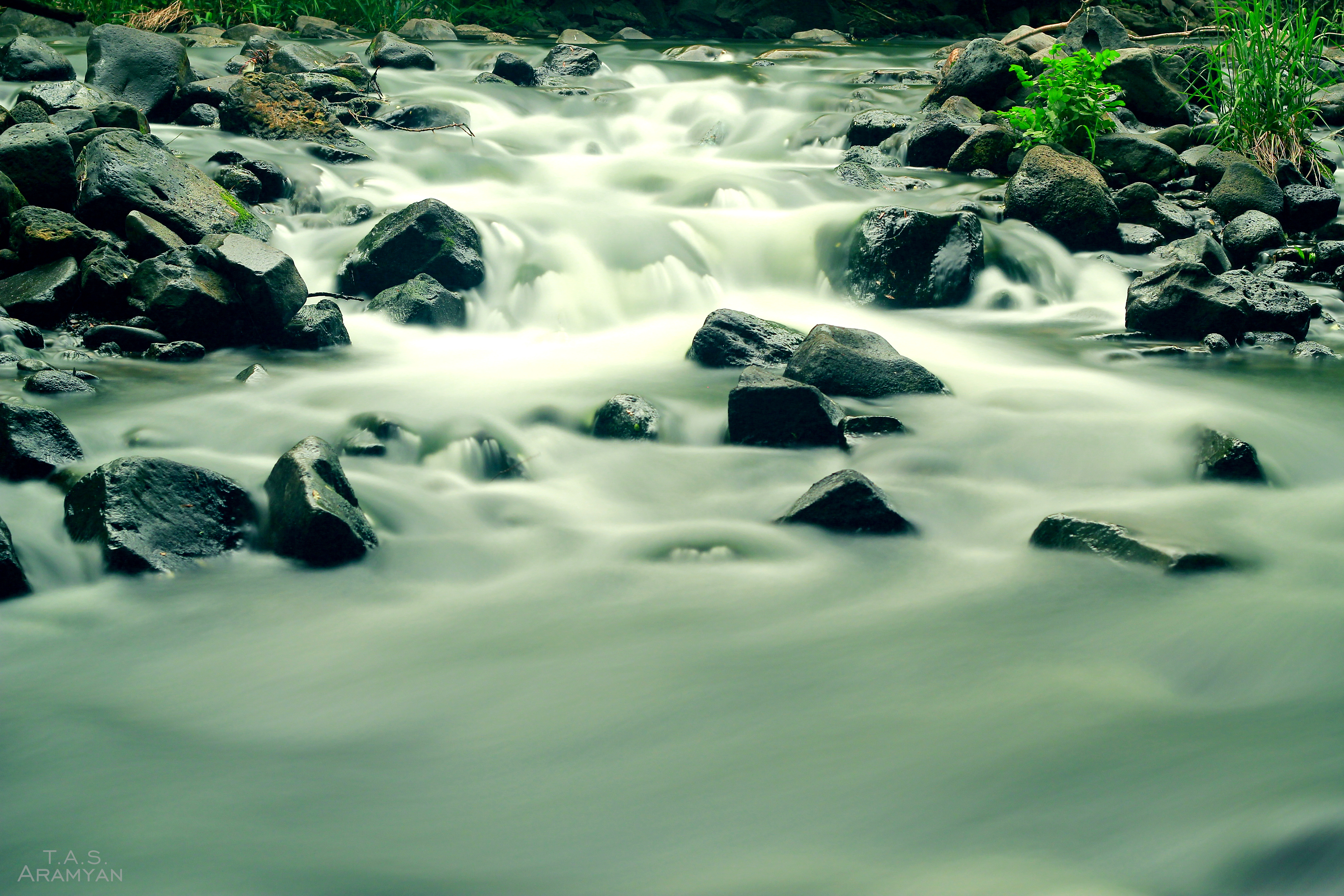 Mist-obscured rocks from rapids.jpg