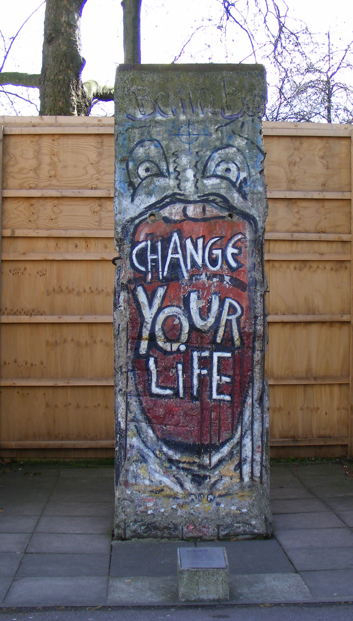 file berlin wall graffiti 39 change your life 39 by indiano. Black Bedroom Furniture Sets. Home Design Ideas