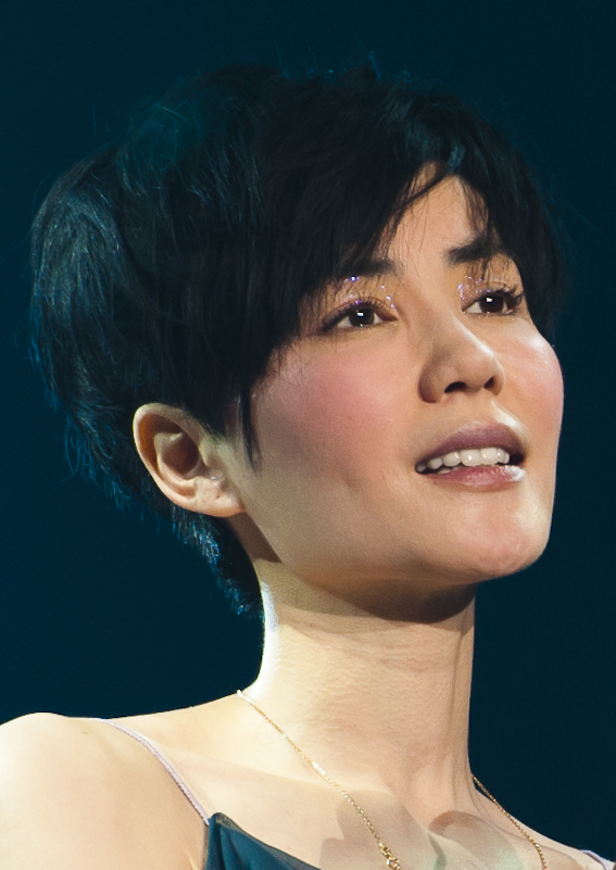 The 49-year old daughter of father Wang Youlin and mother Xia Guiyin Faye Wong in 2018 photo. Faye Wong earned a  million dollar salary - leaving the net worth at 150 million in 2018
