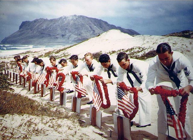 Sailors honor the Pearl Harbor dead in Hawaiian tradition.