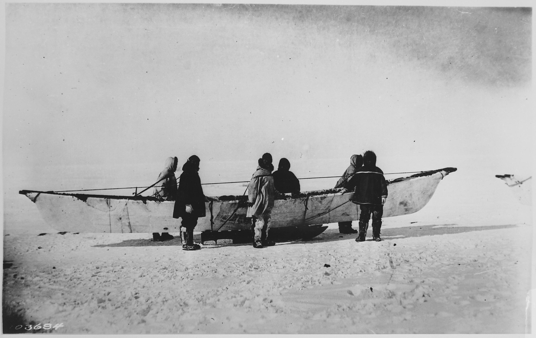 Eskimos Standing Beside Umiak On Sled Point Barrow Alaska