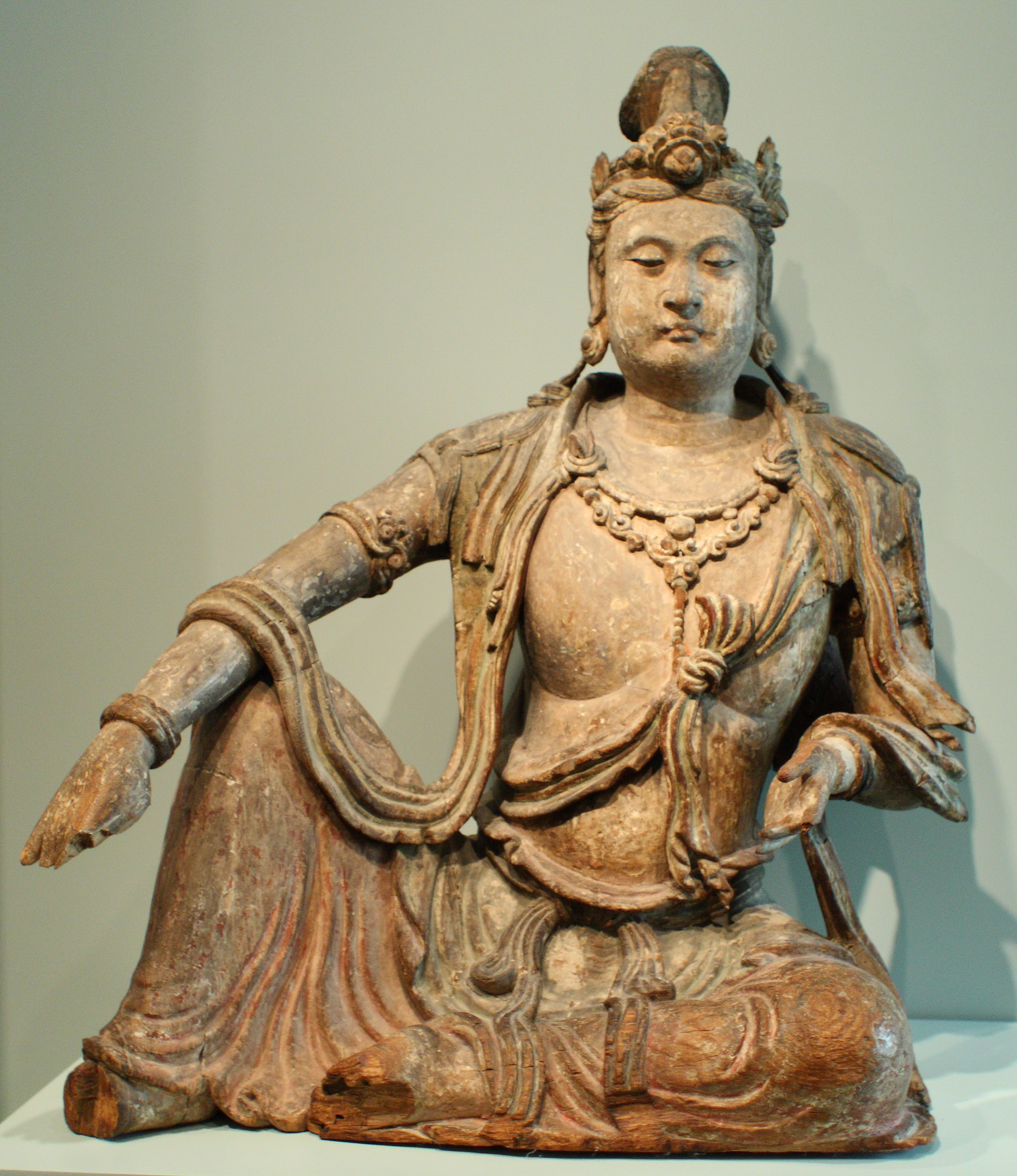 the sculpture bodhisattva In buddhist art, a bodhisattva may appear in divine form wearing crowns and jewels, as an ordinary human, or even as a animal avalokiteshvara is one of the most popular of the hundreds of bodhisattvas commonly depicted in buddhist art.