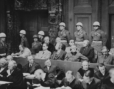 Defendants listening to translated evidence through headphones The defendants at Nuremberg Trials.jpg