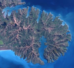 Banks Peninsula is roughly circular, with many bays and two deep harbours. Banks Peninsula from space.jpg