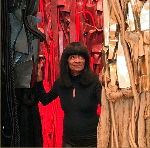 Barbara Chase-Riboud with her Malcolm X steles, Michael Rosenfeld Gallery.