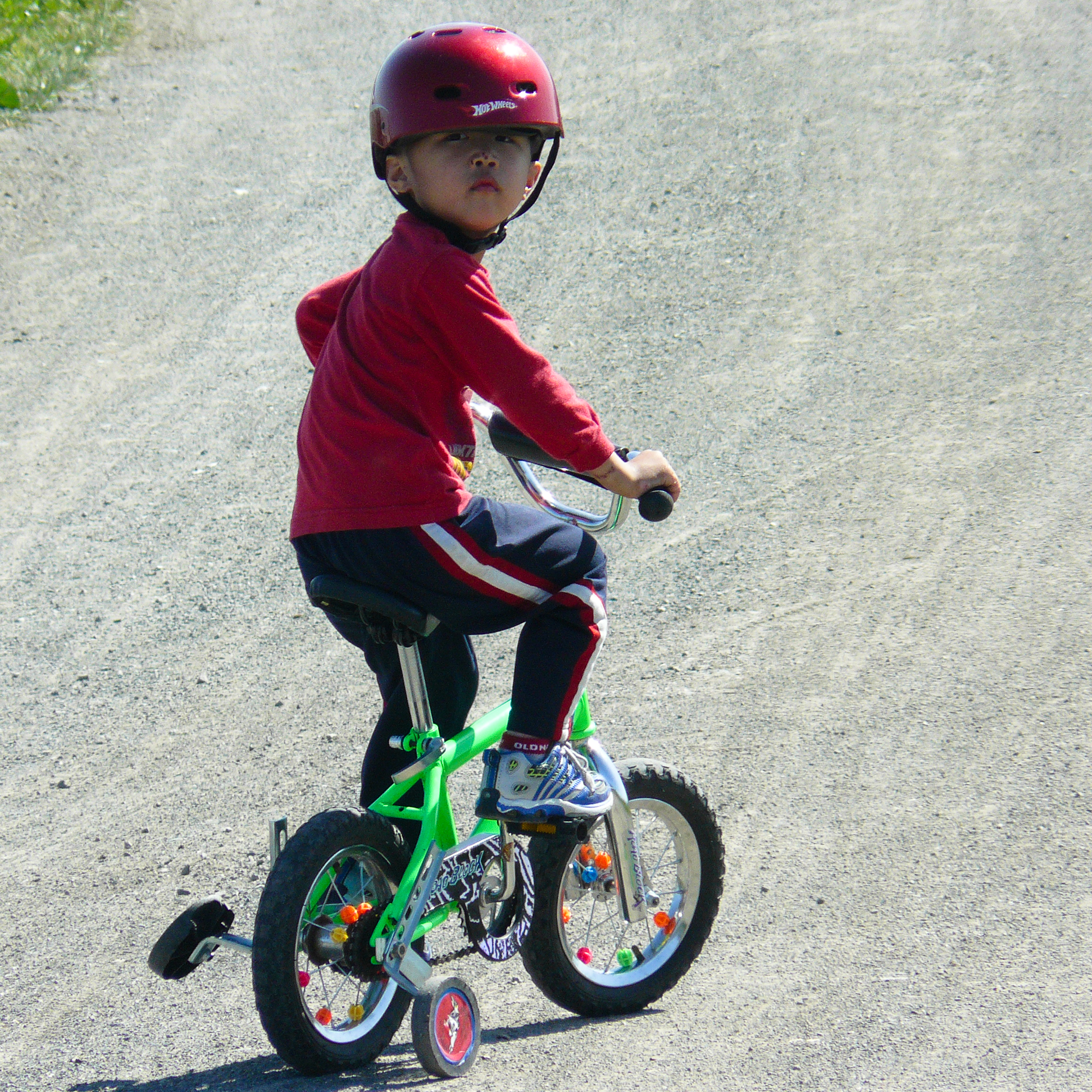 Bikes With Training Wheels For Boys File Helmeted boy on training