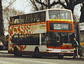 Lothian Buses bus Dennis Trident Plaxton President Harlequin livery with red route branding, March 2002.jpg