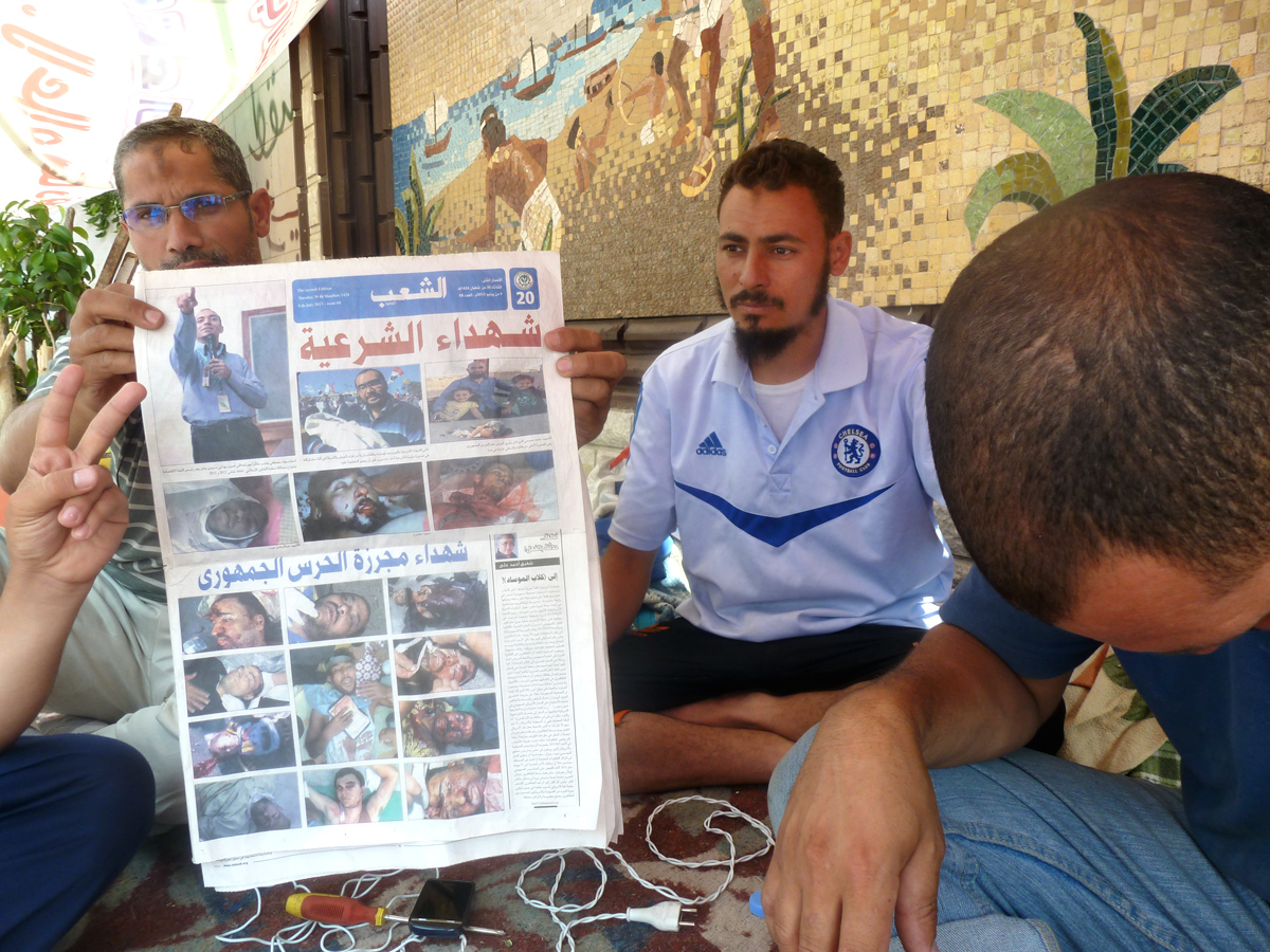 Muslim Brotherhood doctors showing photos of anti-coup protesters killed on July 8th 2013