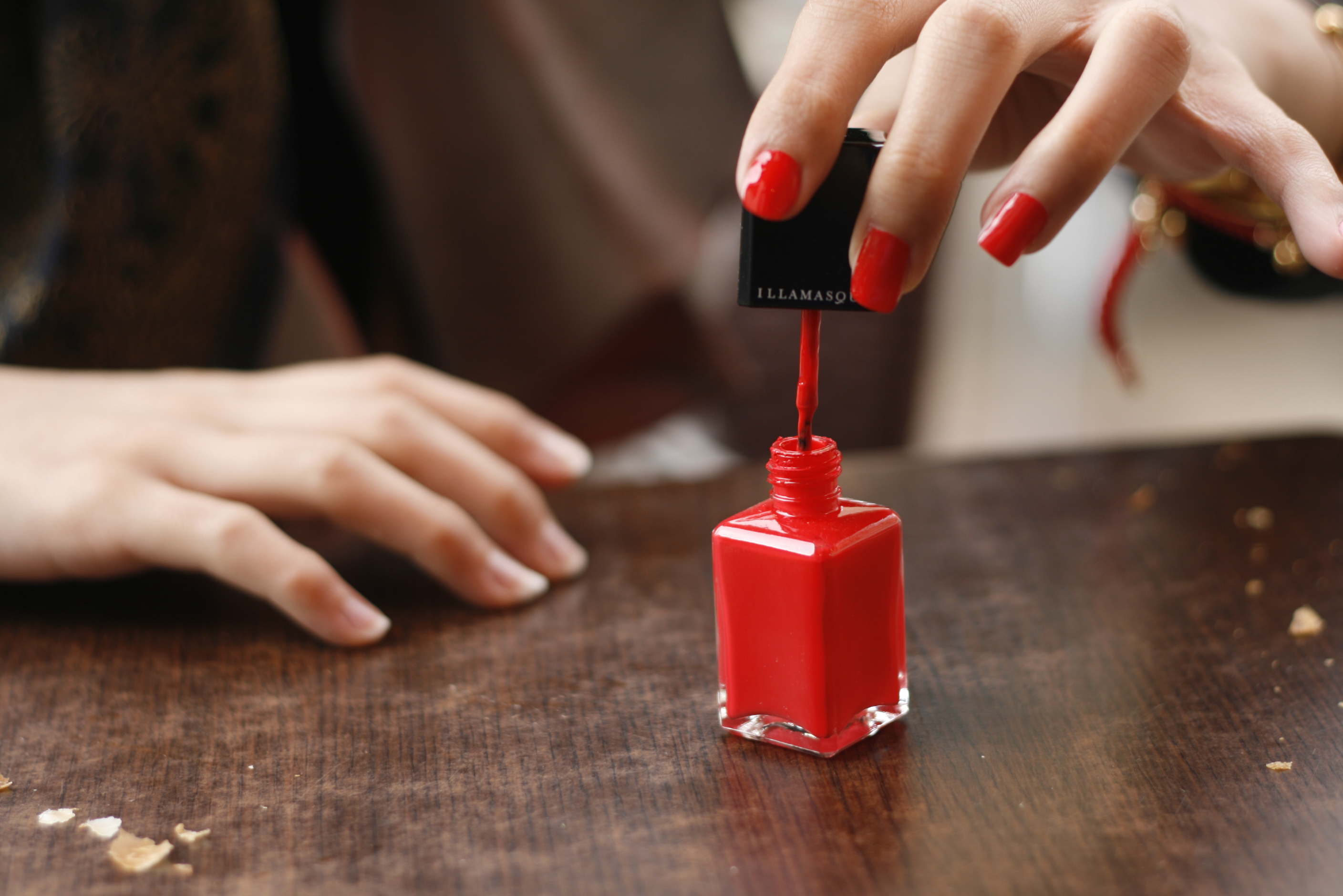 Red nail polish in application.jpg