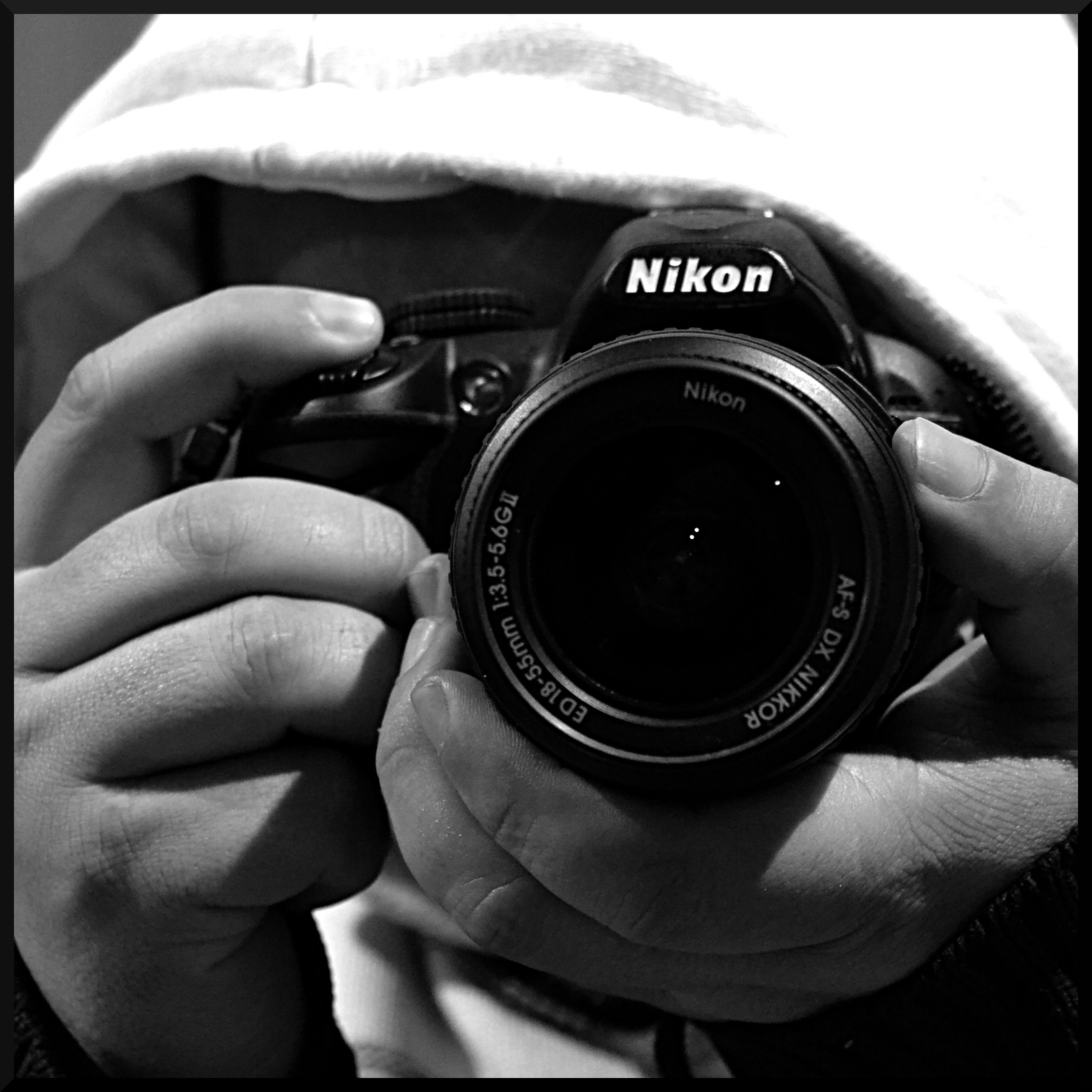 File:Shooting with Nikon D3100, 2012.jpg - Wikimedia Commons