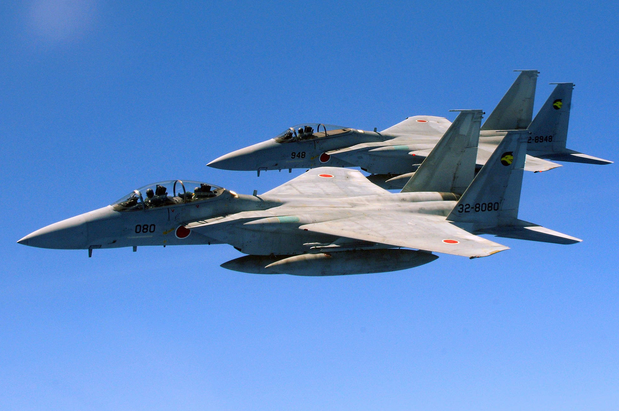 http://upload.wikimedia.org/wikipedia/commons/f/ff/Two_Japan_Air_Self_Defense_Force_F-15_jets.jpg