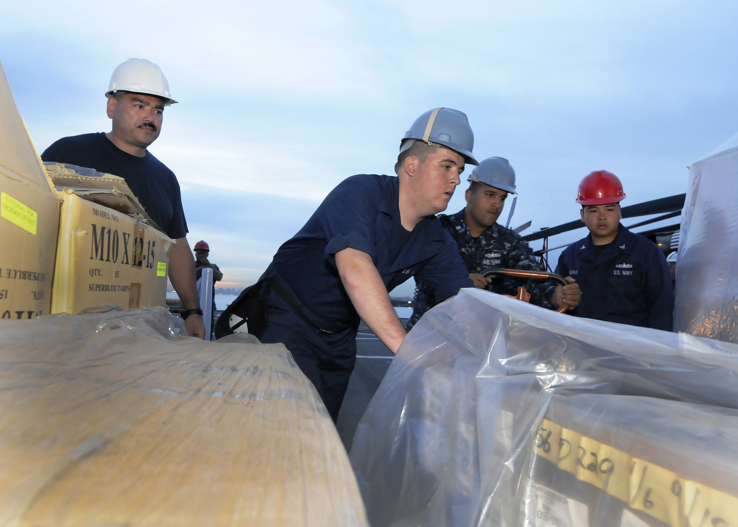 US Navy 110311-N-5716H-290 Sailors load humanitarian assistance supplies aboard the U.S. 7th Fleet command ship USS Blue Ridge (LCC 19) in Singapor.jpg