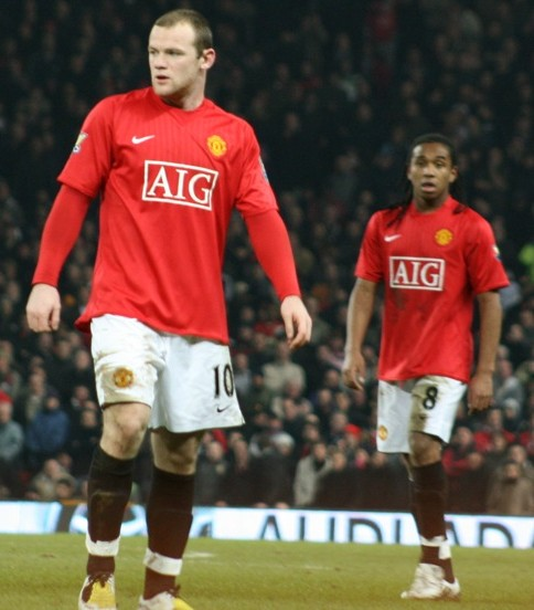 Wayne Rooney (left) seen here with Anderson, scored a penalty to help Manchester United on their way to yet another victory against QPR (Gordon Flood/Wikimedia Commons).