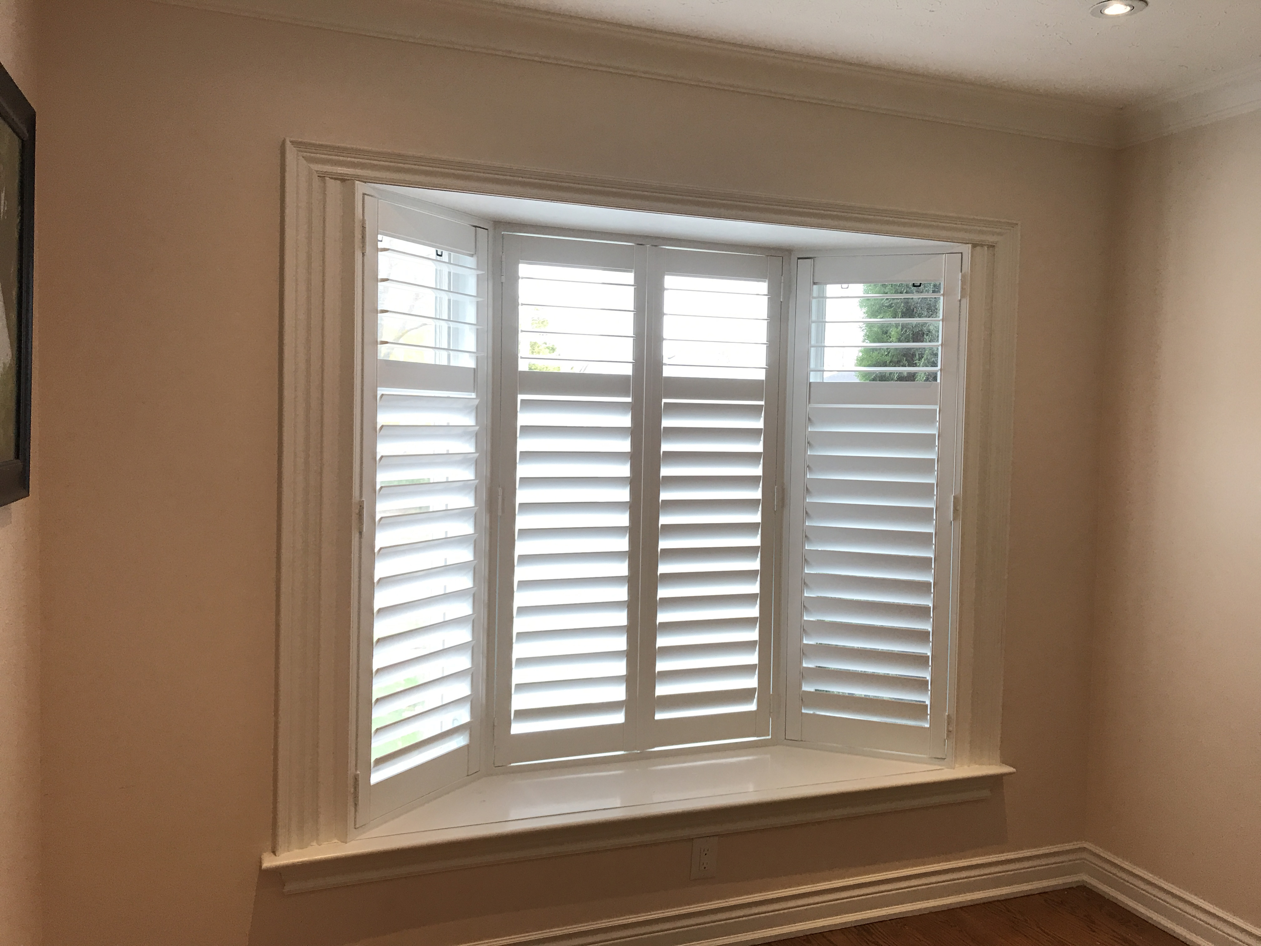 File White California Shutters Fitted To A Bay Window In