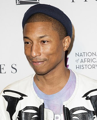 "Pharrell Williams (pictured in 2016) co-wrote and produced the track. ""Hidden Figures"" Screening at NMAAHC (NHQ201612140033) (cropped).jpg"