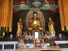 Temple with Buddha image, flanked by Ānanda and Mahākāśyapa