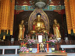 Temple with Buddha image, flanked by Ānanda and Mahākassapa