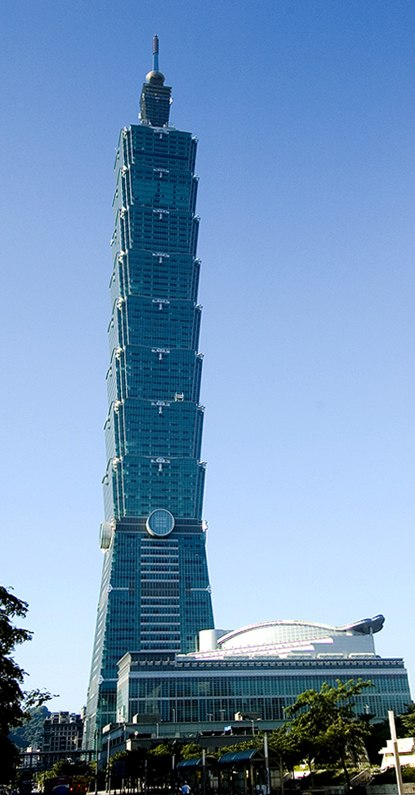 Photo of Taipei 101 tower against a blue sky.