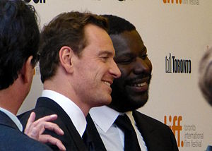 Steve McQueen (director) - McQueen with Michael Fassbender at the premiere of 12 Years a Slave at the 2013 Toronto Film Festival