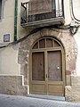 135 Cal Bià (Olesa), façana c. Coscoll 2.jpg
