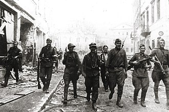 Operation Ostra Brama - Soviet and Home Army soldiers on patrol together in the streets of Wilno on July 12th, 1944. While the Home Army and the Red Army cooperated in liberating the city from the Germans (July 7th - July 15th), after this was accomplished, on July 16th, the Soviets arrested and interned the Polish officers.
