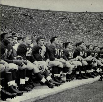 1950 Michigan Wolverines football team - Michigan players on the sidelines at Michigan Stadium, 1950