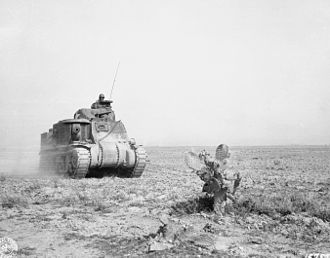 Battle of Kasserine Pass - An M3 Lee tank of U.S. 1st Armored Division advancing to support American forces during the battle at Kasserine Pass