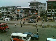 A picture of a view of a street in First Artillery, Port Harcourt from a few floors up.