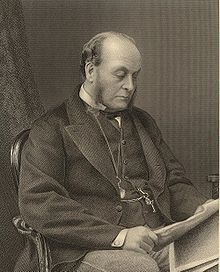 A balding man, with sideburns, sitting in a chair and reading a newspaper. He wears a dark suit and waistcoat with a stiff-collared white shirt, and a pocket watch hangs from a chain around his neck