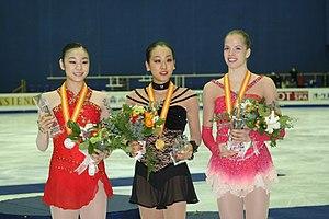 2008–09 Grand Prix of Figure Skating Final - The ladies' podium. From left: Kim Yuna (2nd), Mao Asada (1st), Carolina Kostner (3rd).