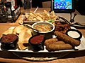2018-02-22 16 52 42 Classic appetizer combo (Chips with spinach-artichoke dip, mozzarella sticks, honey-bbq buffalo wings and chicken quesadilla) at the Applebee's in Fair Lakes, Fairfax County, Virginia.jpg