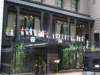 Lawn jockey - The entrance the 21 Club in Manhattan uses 33 jockeys to welcome its patrons