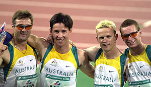 Athletics at the 2000 Summer Paralympics - Australian track athletes (L-R) Neil Fuller, Stephen Wilson, Tim Matthews and Heath Francis after their gold medal win in the 4 x 400 m T46 relay, 2000 Summer Paralympics