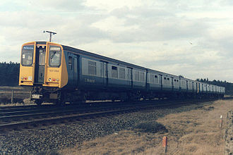British Rail Class 507 - 507004 and 507011 in BR blue and grey with Merseyrail logo, seen at Freshfield in 1986.