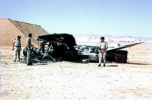 Preemptive war - Israeli Air Force personnel inspect the wreckage of an Egyptian aircraft shot down over Sinai during the Six-Day War.